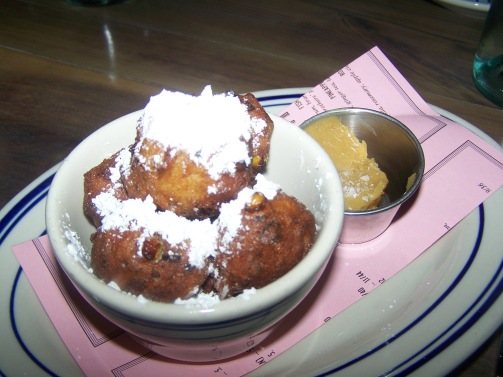 "Corn milk hushpuppies, served ""beignet style"" along with cane sugar butter - $6."