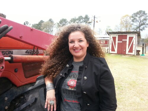 Me hanging out next to the Massey Ferguson tractor on the farm.
