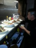 Head Chef Stephen puts the final touches on entrees before the plates are delivered to tables.