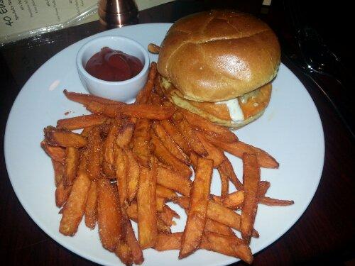 Buffalo chicken sandwich served with crispy sweet potato fries.