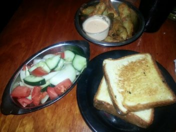Clockwise: Fried okra, tomato salad and Texas toast.