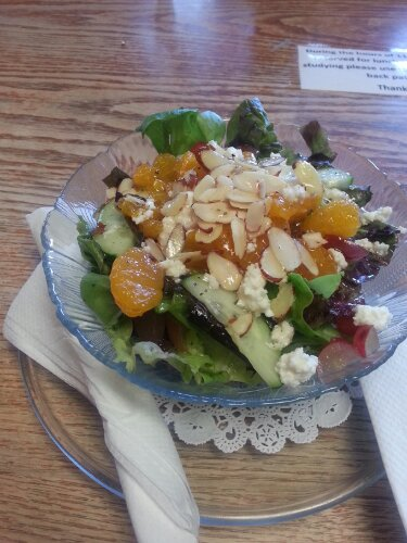 Side salad featuring The Daily Grind's house-made Italian dressing.