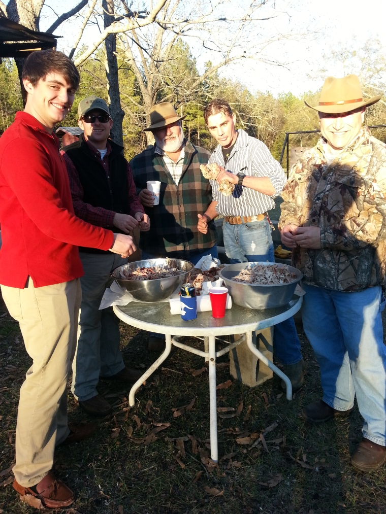 "My cousins and uncles lend a hand to help shred the meat. From left: Park Burford, James Faulk, Uncle ""Bimbo,"" Randy Faulk and Uncle Norman."