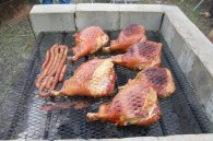 The meat is smoked for 8 - 10 hours in the pit.