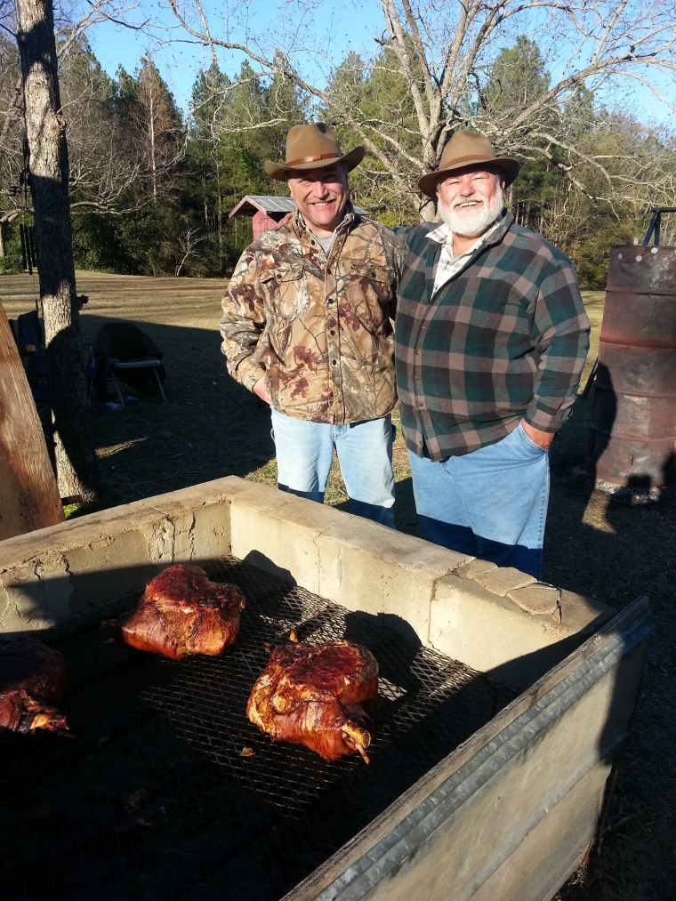 """From left: Uncle Norman and Uncle """"Bimbo"""" have been a part of The Cookin' since the day they were born. The age-old fire barrel stands in the background."""