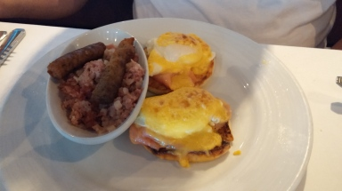 Eggs Benedict with corn beef hash and sausage
