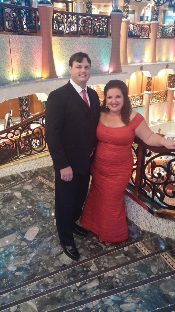 Owning the cruise ship in our red elegant evening attire.