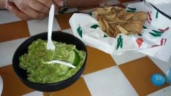 Fresh guacamole with homemade tortilla chips