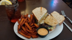 Fried Green Tomato Burger with Sweet Potato Fries and House-made Radish Sauce