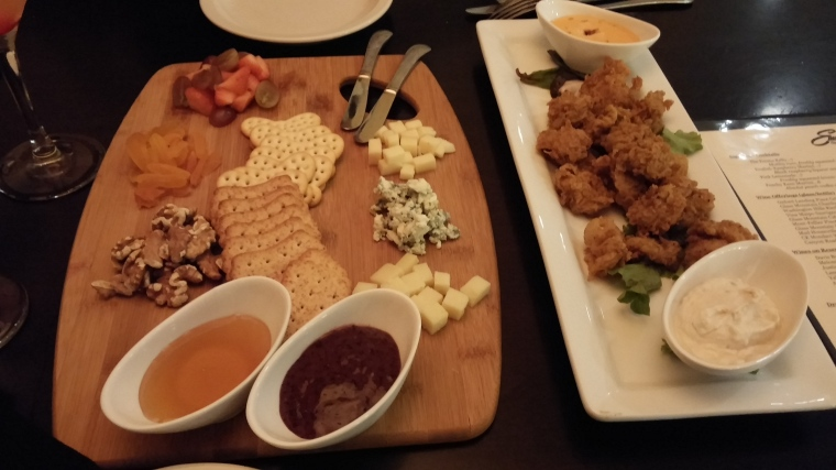 A beautiful cheese board (left) and cajun fried oysters (right).