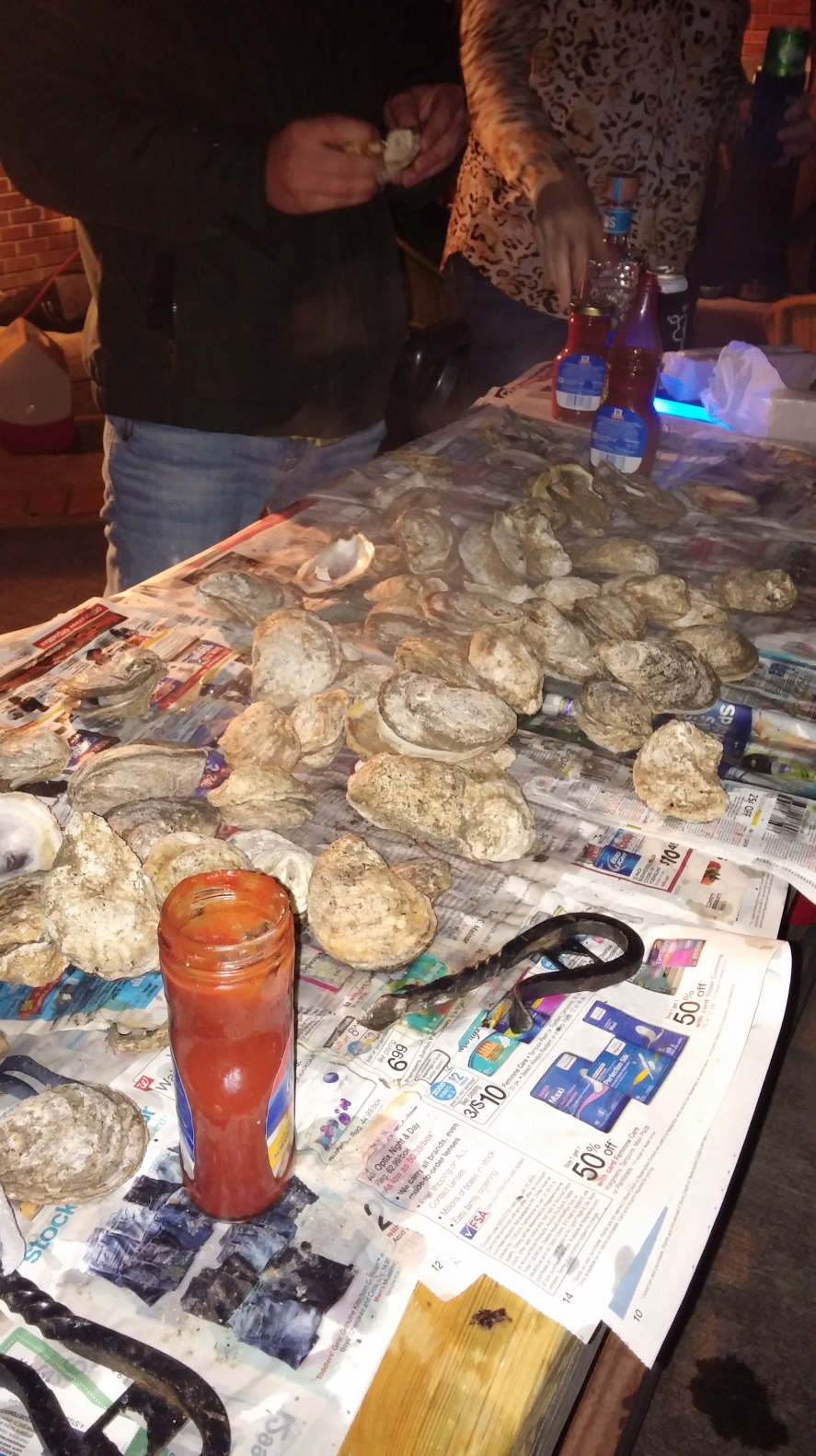 An oyster roast is one of the most casual ways to throw a coastal party while highlighting local ingredients.