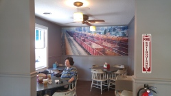 Boxcar wall art fills the dining room.