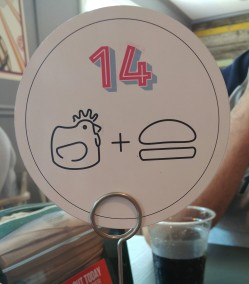 Customers receive a table number to take to their seats.