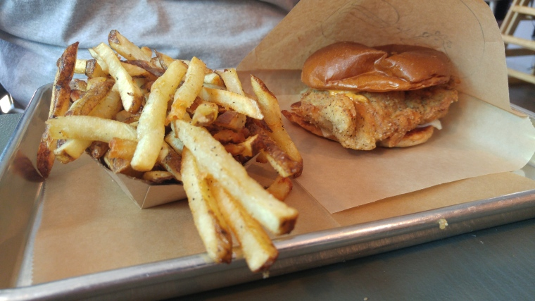 A custom fried chicken sandwich with handcut fries.