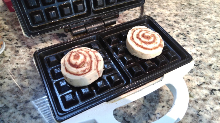 Pop the cinnamon rolls on a greased waffle iron, and shut it. Simple.