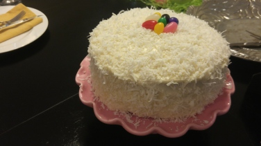 Ina Garten's Coconut Cake garnished with festive Jelly Beans