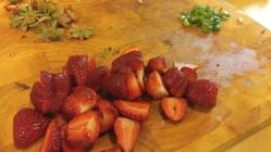 Freshly hulled and sliced strawberries