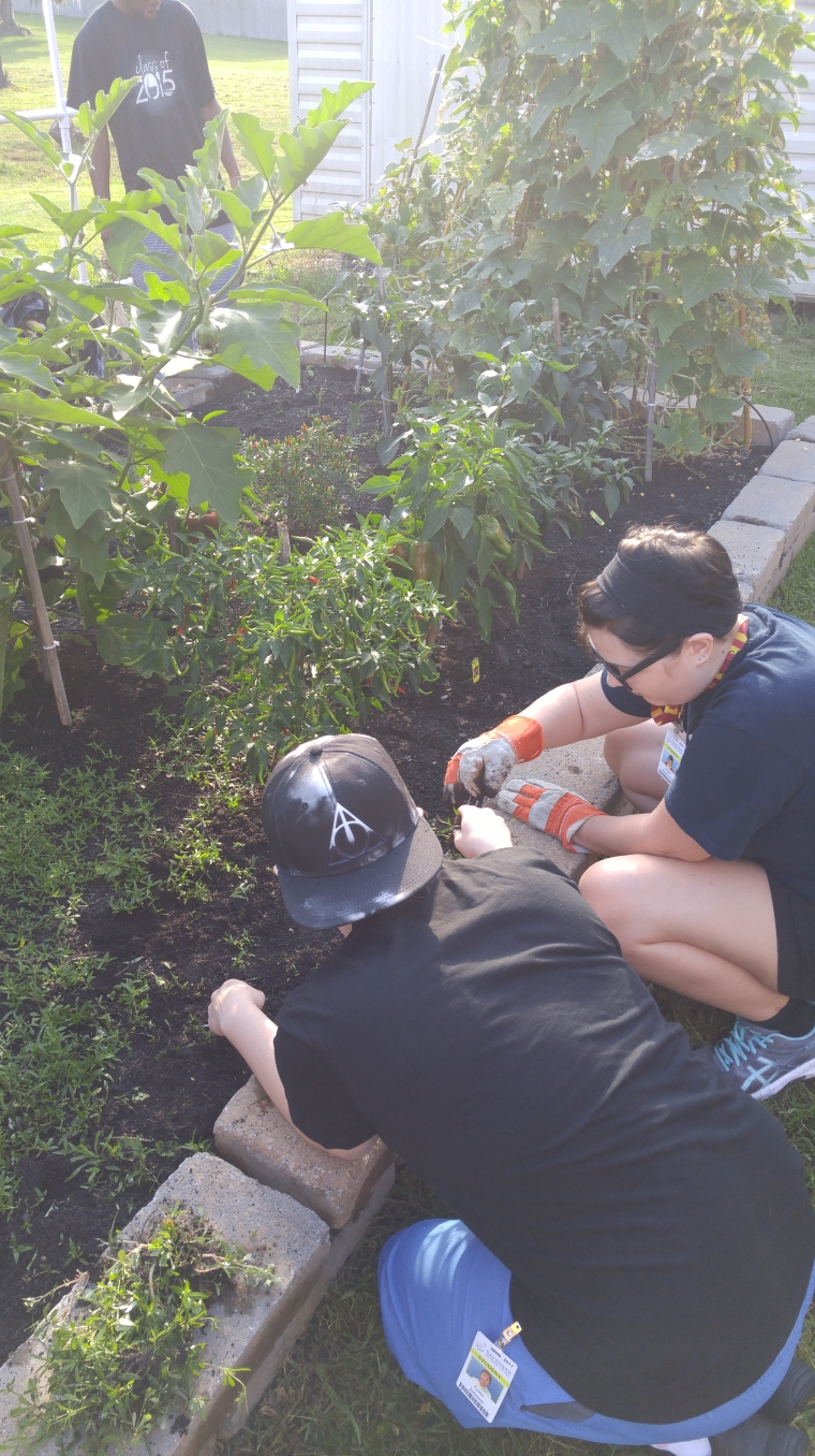 Taylor and Johnnie working to make our garden prettier!