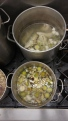 Fish and veal stocks simmer on the stovetop.