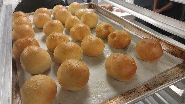 Soft white dinner rolls, fresh from the oven.