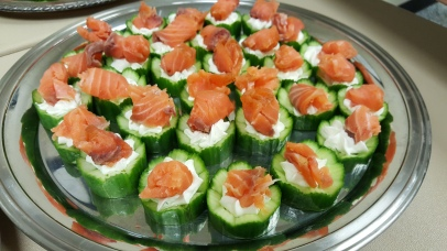 Smoked salmon over herb and cream cheese stuffed cucumbers