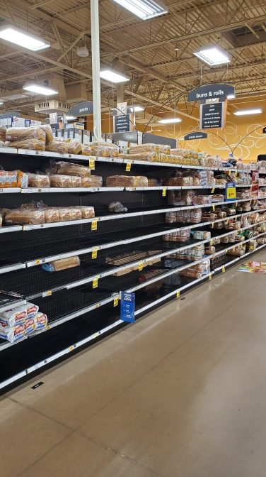In anticipation of Hurricane Dorian, the bread and canned vegetable aisles are picked over at the local Kroger.